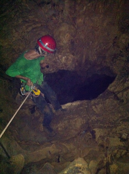 Stewart about to descend the third entrance pit of St Clair Cave, Jun 9/12 - Photo: A Hyde
